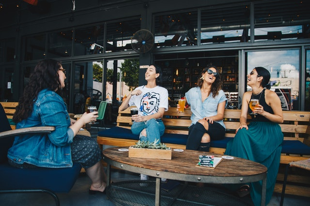 women chatting in a restaurant